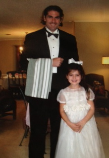 Playing the waiter at her 6th birthday tea party.