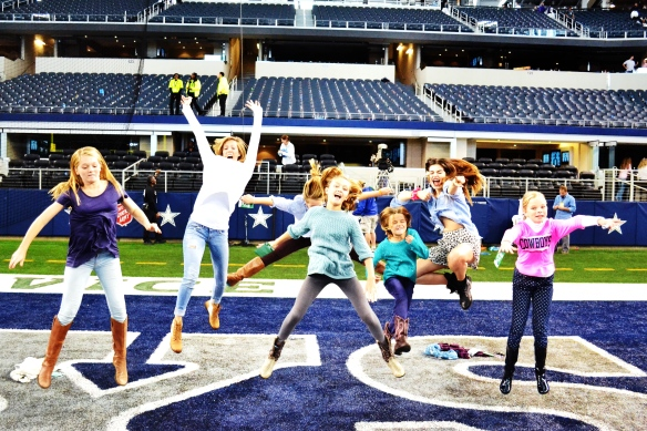 Some of the Turtle girls performing as cheerleaders on the Cowboys field.