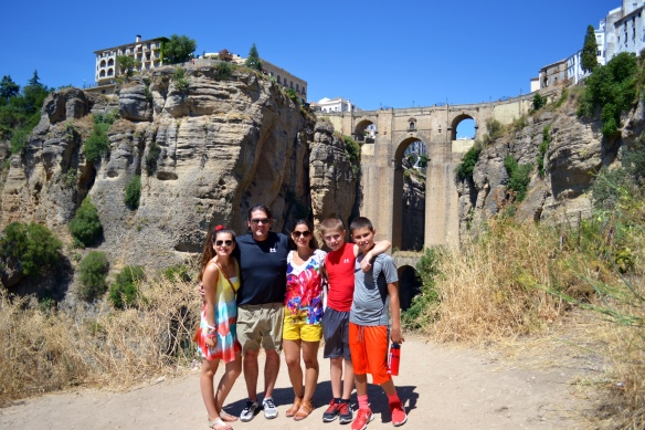 In front of the Old Bridge in Ronda, Spain.